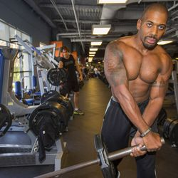 """<a href=""""http://la.racked.com/archives/2013/08/06/hottest_trainer_contestant_3_quincy_burgers.php""""target=""""_blank"""">Quincy Burgers of Crunch WeHo</a>"""