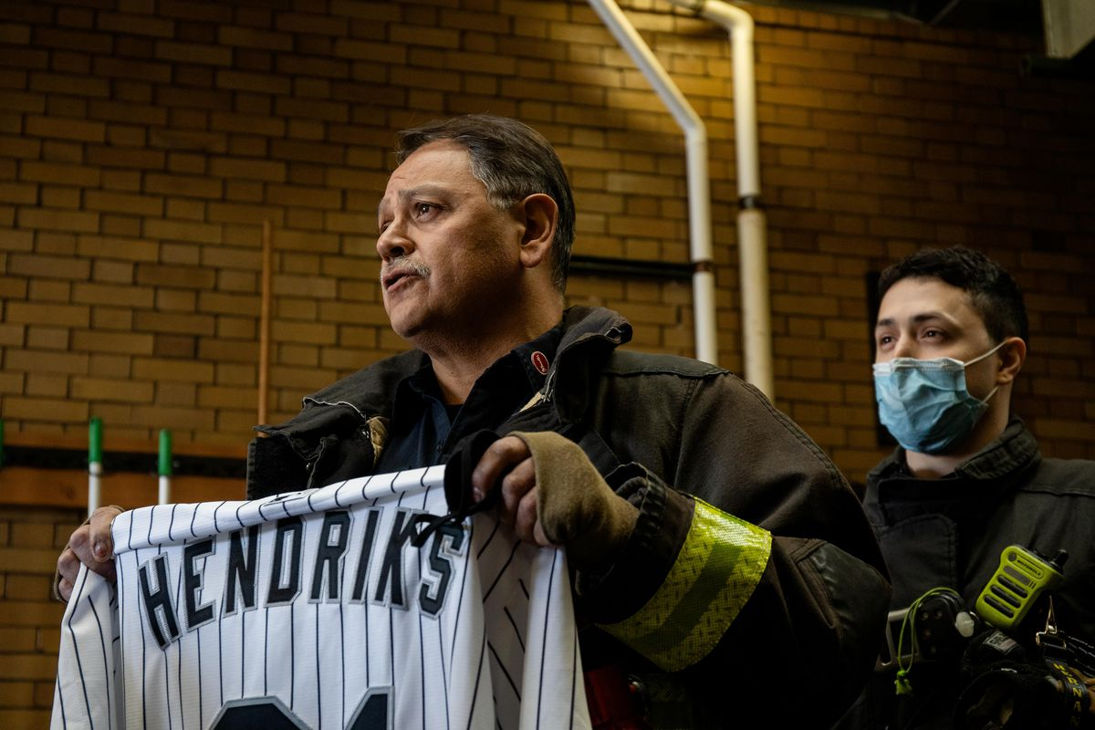Chicago Fire Department Lt. Dan Ruano thanks White Sox pitcher Liam Hendriks and his wife Kristi, who donated food from local restaurants to firefighters Thursday at Engine 29 in Bridgeport.