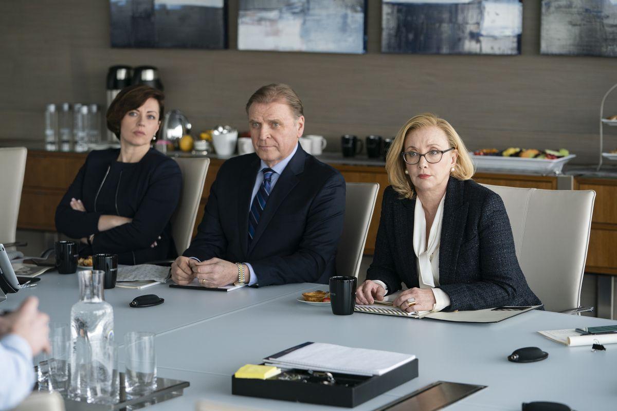 Karolina (Dagmara Domińczyk), Karl (David Rasche), and Gerri (J. Smith-Cameron) all sit at a table.