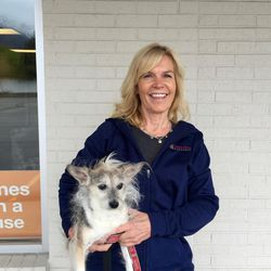 Cathy King of Canines With a Cause holds her friend Angel.