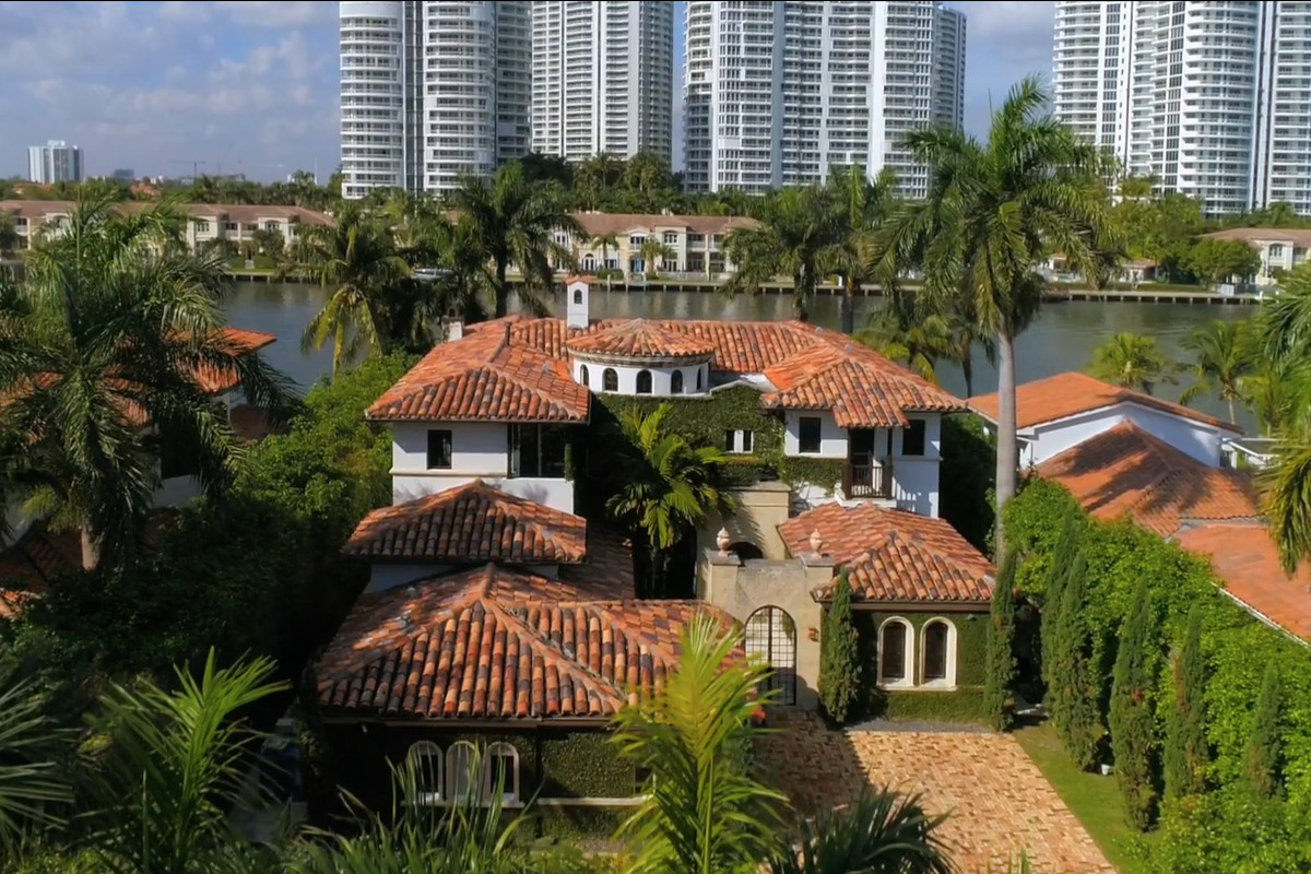 A modern mediterranean mansion on the water in golden beach with the intracoastal behind it