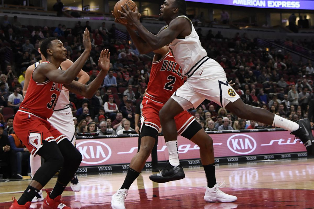 86e709674c79 Denver Nuggets forward Paul Millsap (4) drives to the basket as Chicago  Bulls forward Wendell Carter Jr. (34) defends during the first half of an  NBA ...