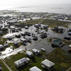 This aerial photo shows flooding from Grand Isle, La. in the aftermath of Isaac, Friday, Aug. 31, 2012. Isaac is now a tropical depression, with the center on track to cross Arkansas on Friday and southern Missouri on Friday night, spreading rain through the regions.