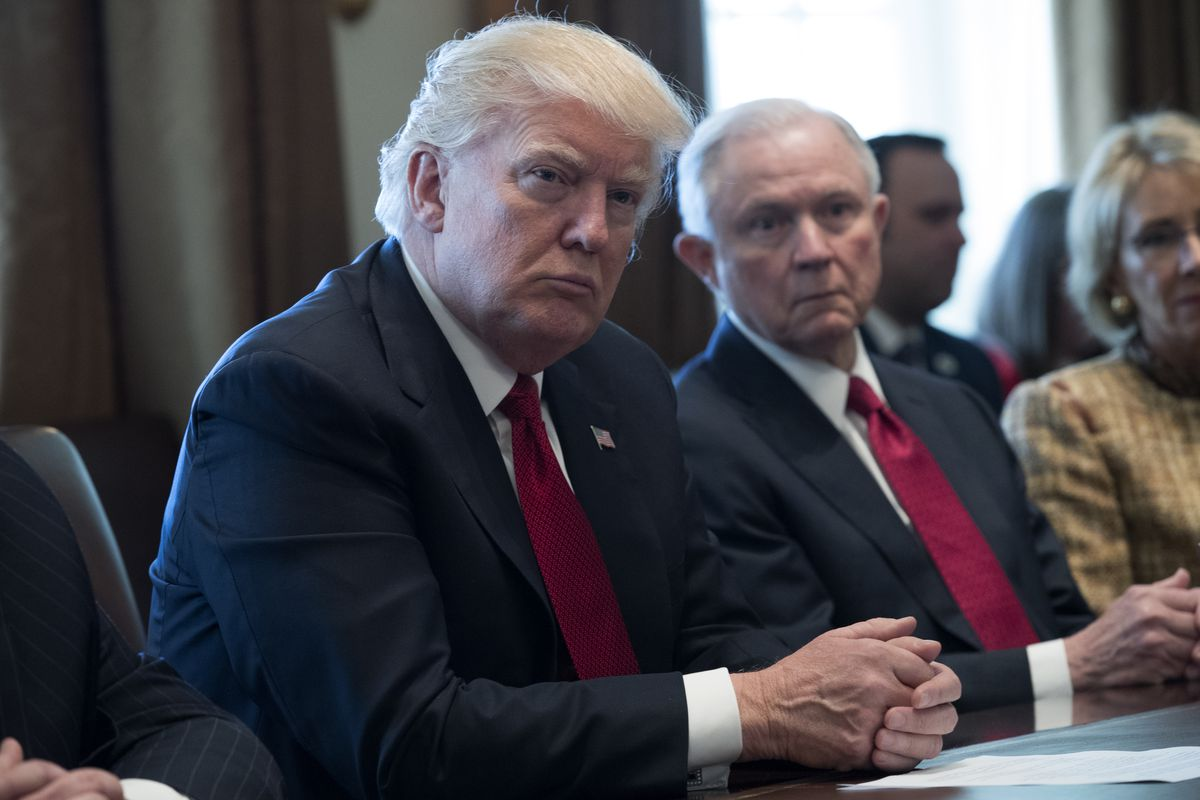 President Trump attending a panel discussion sitting beside Attorney General Jeff Sessions