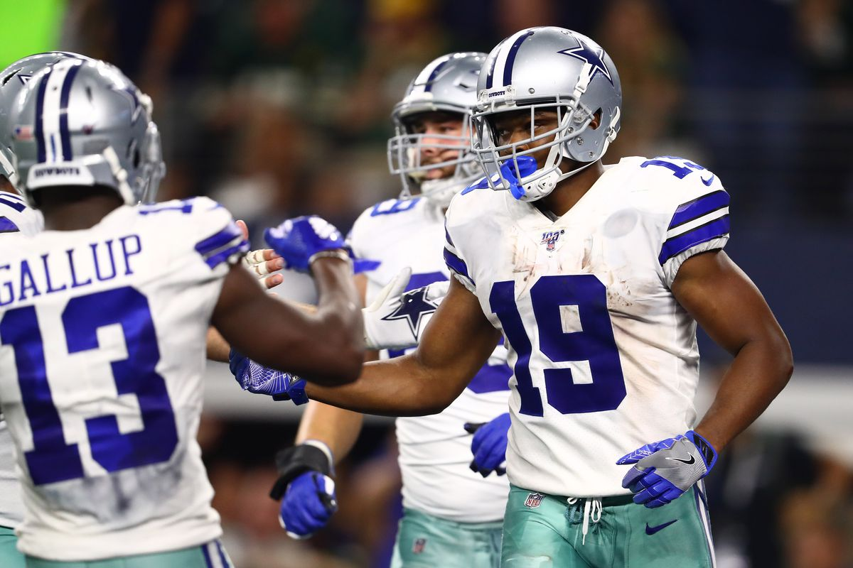 Dallas Cowboys receiver Amari Cooper celebrates his fourth quarter touchdown against the Green Bay Packers at AT&T Stadium.
