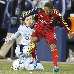 Kansas City's Chance Myers slide tackles Real's Joao Plata as Real Salt Lake and Sporting KC play Saturday, Dec. 7, 2013 in MLS Cup action. Sporting KC won in a shootout.