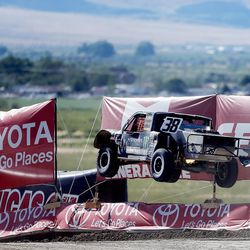 Brian Deegan in the Monster Energy 38 truck flies through the air as racers compete in the Pro 2 division in the Lucas Off-Road races in Tooele on Saturday, June 24, 2017.