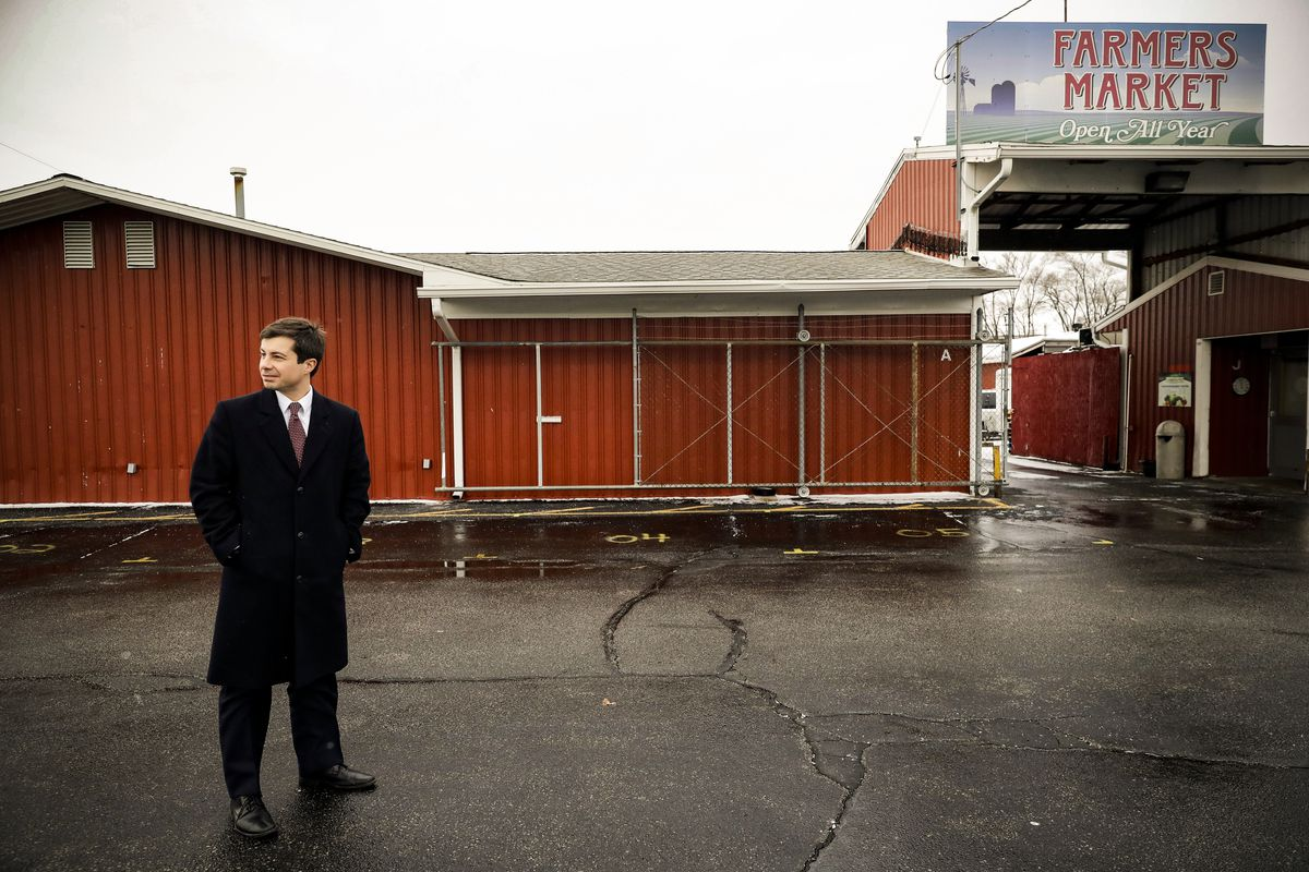 Pete Buttigieg looks around at Farmers Market in South Bend, Ind., Thursday, Jan. 10, 2019.