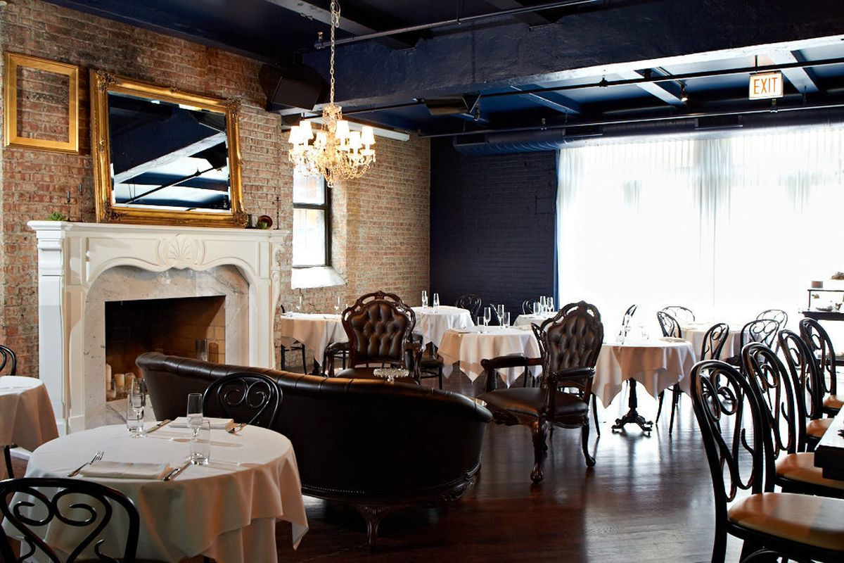 The elegant lounge setting evokes a Parisian parlor