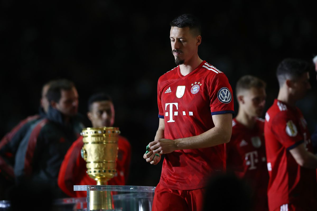 BERLIN, GERMANY - MAY 19: Sandro Wagner of Muenchen walks of the podium after he received his medal during the DFB Cup final between Bayern Muenchen and Eintracht Frankfurt at Olympiastadion on May 19, 2018 in Berlin, Germany.