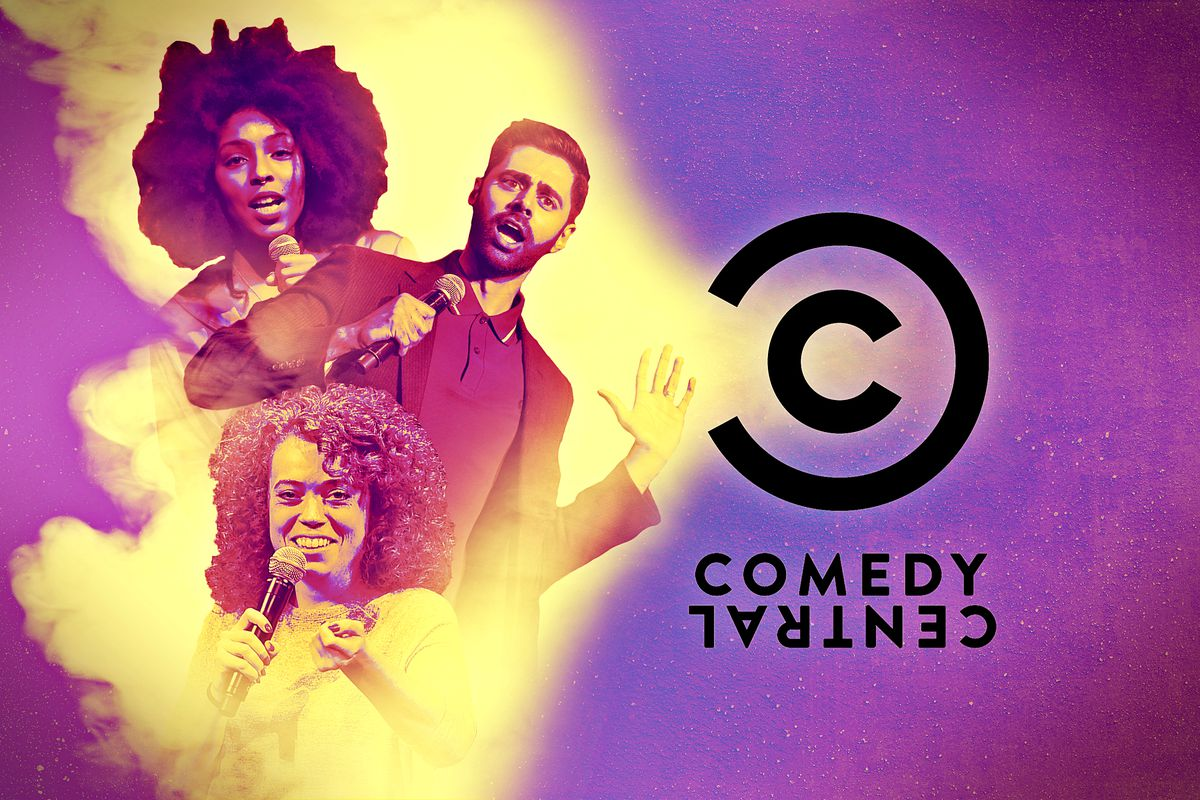 A Comedy Central logo emitting a ray of light on Jessica Williams, Michelle Wolf, and Hassan Minhaj