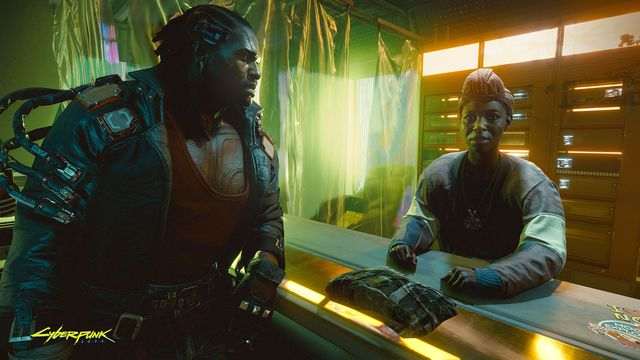 A man interacts with a woman at a counter in a screenshot from Cyberpunk 2077