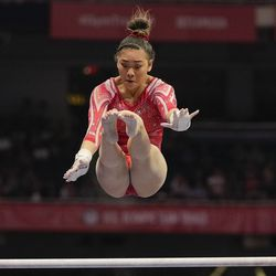 Suni Lee competes on the uneven bars during the women's U.S. Olympic Gymnastics Trials Sunday, June 27, 2021, in St. Louis.
