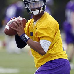 In this Wednesday, April 11, 2012 photo,  East Carolina quarterback Rio Johnson looks to pass during football practice in Greenville, N.C. With Dominique Davis gone, East Carolina has an open race for its starting quarterback job.