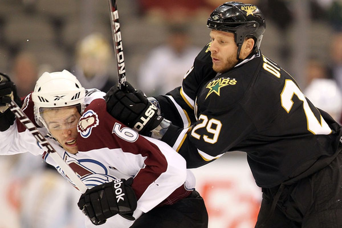 DALLAS - SEPTEMBER 30:  Center Steve Ott #29 of the Dallas Stars checks Jonas Holos #6 of the Colorado Avalanche in the first period at American Airlines Center on September 30 2010 in Dallas Texas.  (Photo by Ronald Martinez/Getty Images)