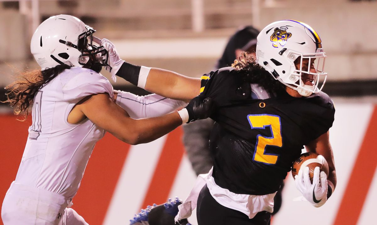 Orem's Noah Sewell fends off Pine View's Mason Katoa on his way into the end zone for a touchdown as they play in 4A semifinal football action at Rice-Eccles Stadium at the University of Utah in Salt Lake City on Friday, Nov. 9, 2018.