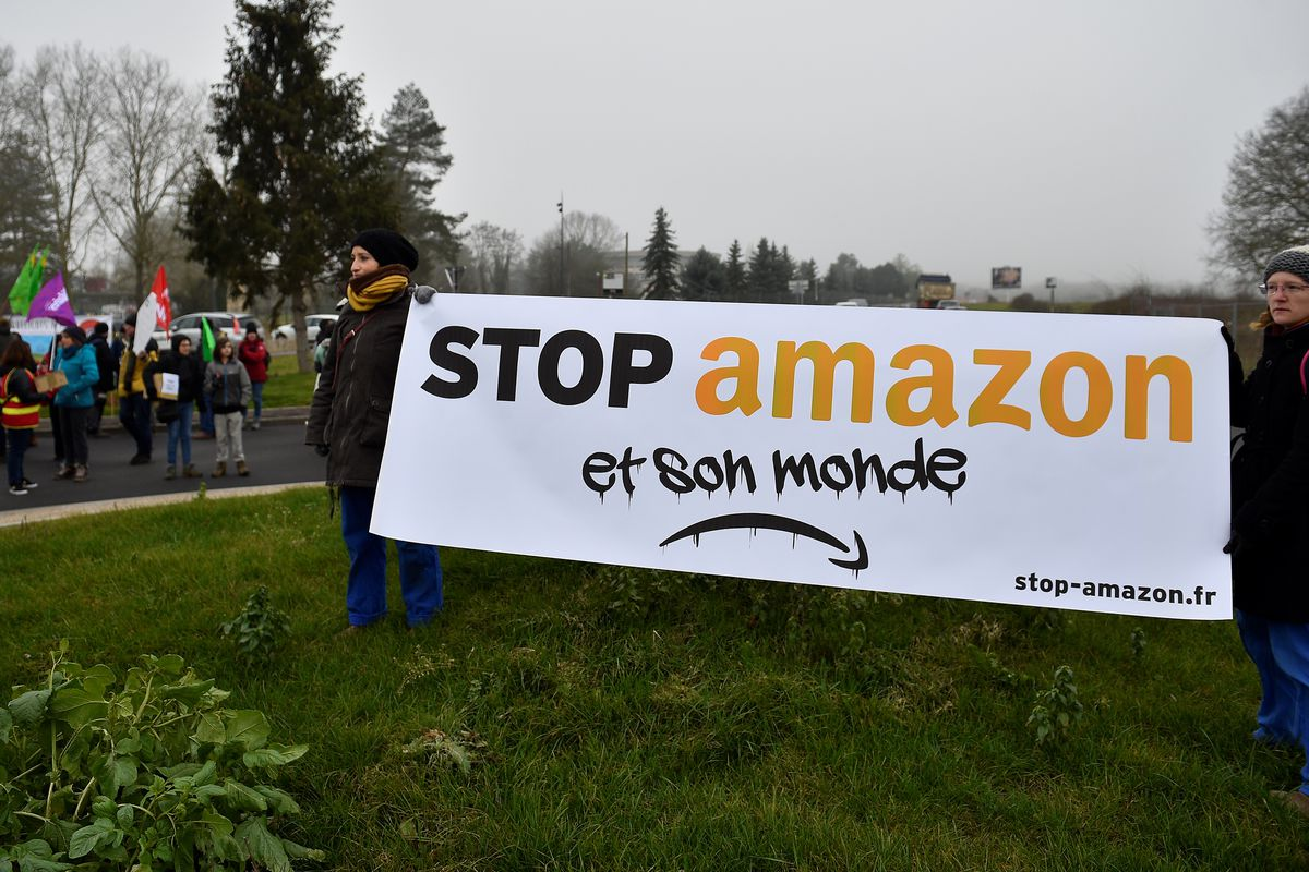 "Protesters hold a ""Stop Amazon"" sign at a protest in France in January 2020."