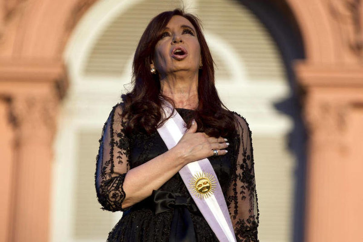 FILE - In this Dec. 10, 2011 file photo, Argentina's President Cristina Fernandez sings her country's national anthem after her swearing-in ceremony outside the government house in Buenos Aires, Argentina. Both supporters and opponents of Fernandez are in