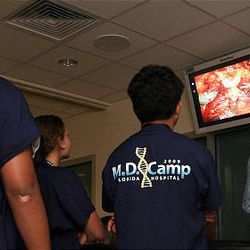Teenagers watch a robotic radical prostatectomy as they participate in Florida Hospital's first-ever medical camp, July 30, in Celebration, Florida.