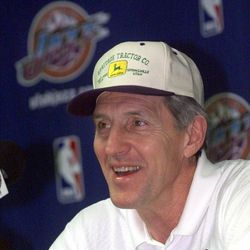 Jerry Sloan answers questions at a press conference announcing a three-year contract extension.