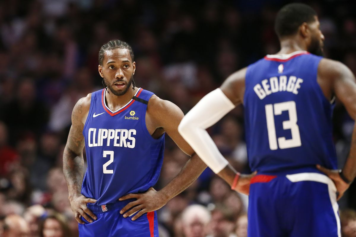 Kawhi Leonard of the LA Clippers looks at Paul George of the LA Clippers during a game at the Staples Center on March 1, 2020 in Los Angeles, CA.