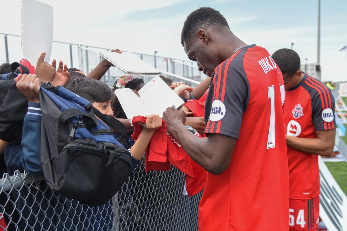 USL Photo - TFC II's Onkony greets young fans after a match against Richmond