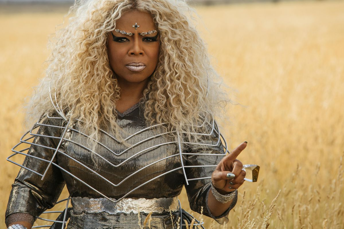 A Wrinkle in Time - Oprah Winfrey as Mrs. Which holding up her finger in a field of wheat