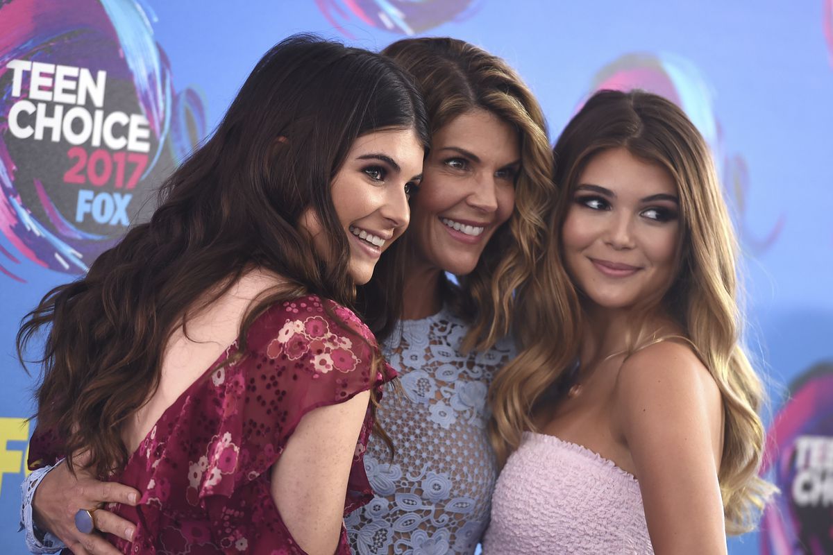 Bella Giannulli, left. Lori Loughlin, and Olivia Giannulli arrive at the Teen Choice Awards at the Galen Center on Sunday, Aug. 13, 2017, in Los Angeles.