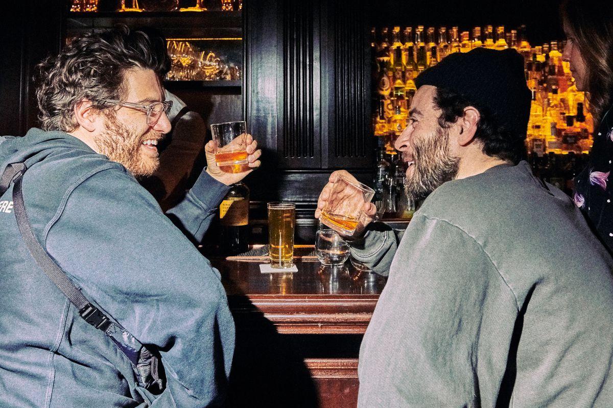 Adam Pally drinking Nikka whisky neat at the Nomad bar