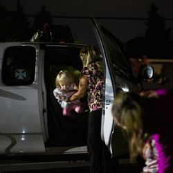 Crissy Norton helps daughter Adrianna Branstetter, 3, out of one of the cars the family lives in at Lake Washington United Methodist Church in Kirkland, Wash.,on Saturday, Oct. 12, 2019. Norton, her husband Matthew Branstetter and three children have been using the Safe Parking program for the past several months.