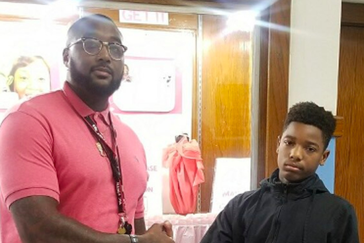 Thomas Fields (left), Paul Robeson Malcolm X Academy's school culture facilitator, with a student. He passed away Monday due to coronavirus complications. Photo courtesy of Jeffery Robinson/Paul Robeson Malcolm X Academy