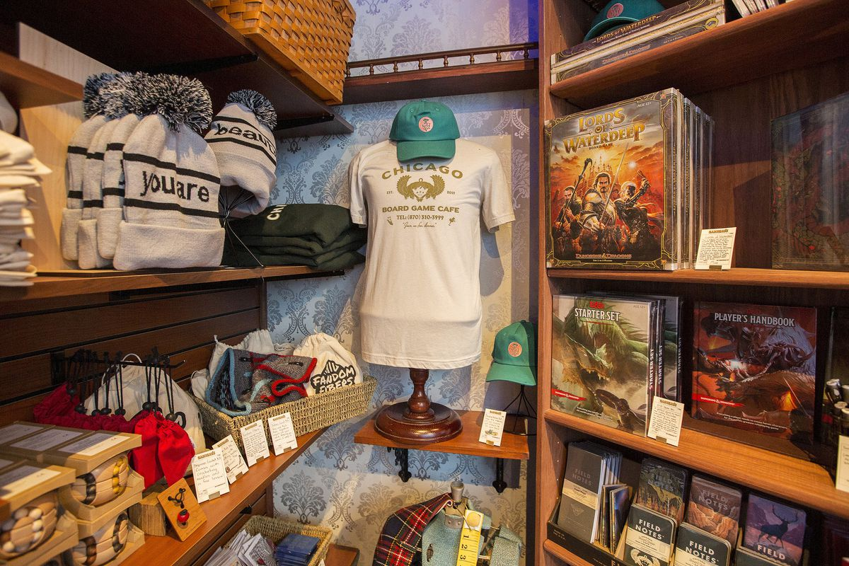 A selection of clothing, including branded hats and t-shirts.