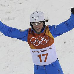 MadisonOlsen, of the United States, celebrates after her jump during the women's freestyle aerial final at Phoenix Snow Park at the 2018 Winter Olympics in Pyeongchang, South Korea, Friday, Feb. 16, 2018. (AP Photo/Gregory Bull)