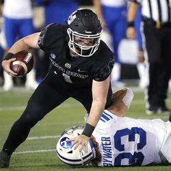 Utah State Aggies quarterback Logan Bonner (1) runs against Brigham Young Cougars linebacker Ben Bywater (33) in Logan on Friday, Oct. 1, 2021.