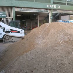 4:26 p.m. Another view of the dirt piled up outside of Gate D -