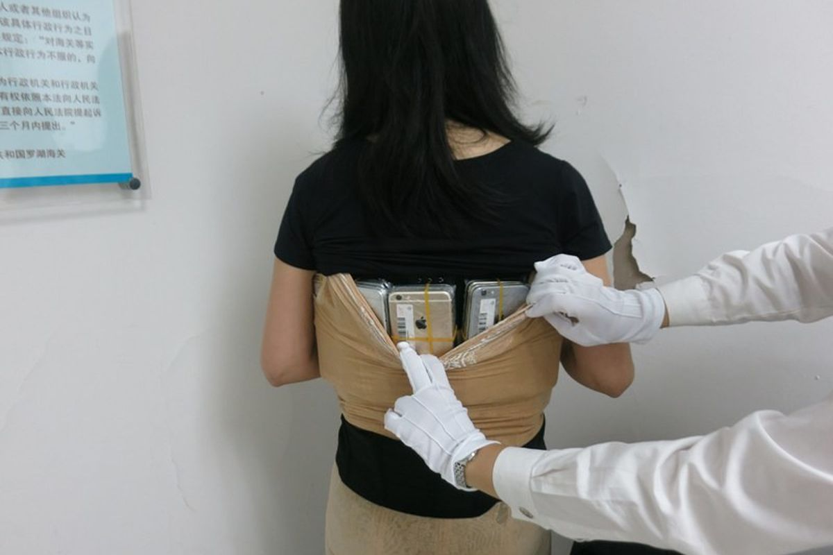 'Female Iron Man' attempts to smuggle 102 iPhones into China
