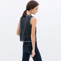 "<strong>Zara</strong> Sleeveless Embroidered Blouse, <a href=""http://www.zara.com/us/en/sale/woman/tops/sleeveless-embroidered-blouse-c437590p1667200.html"">$36</a> (was $99.90)"