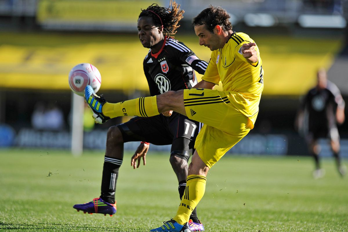 COLUMBUS, OH - OCTOBER 2:  Sebastian Miranda #21 of the Columbus Crew beats Joseph Ngwenya #11 of D.C. United to a loose ball in the first half on October 2, 2011 at Crew Stadium in Columbus, Ohio.   (Photo by Jamie Sabau/Getty Images)