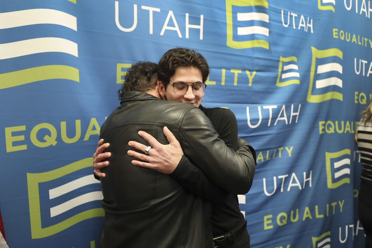 Nathan Dalley, right hugs Justin Utley after a press conference about the practice of conversion therapy at the Capitol in Salt Lake City on Wednesday, Jan. 22, 2020. Utah will become the 19th state in the nation to protect minors from the practice of conversion therapy.