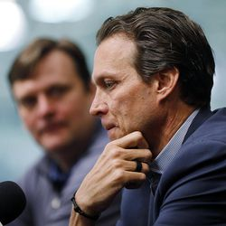 Utah Jazz Head Coach Quin Snyder, front, and Jazz General Manager Dennis Lindsey, talk with the media at Zions Bank Basketball Center in Salt Lake City, Thursday, April 14, 2016.