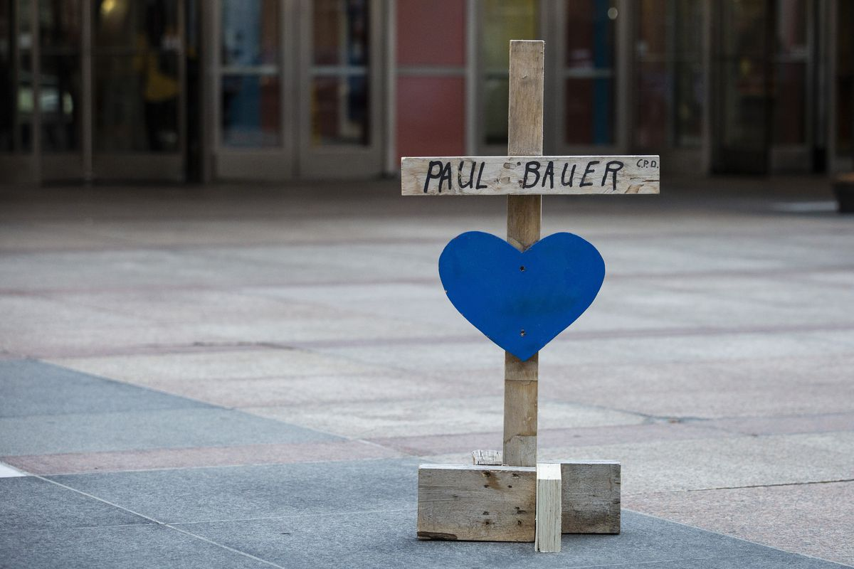 A cross for Chicago Police Cmdr. Paul Bauer by Greg Zanis, of Crosses for Losses, in April 2018, near the location outside the Thompson Center where Bauer was gunned down