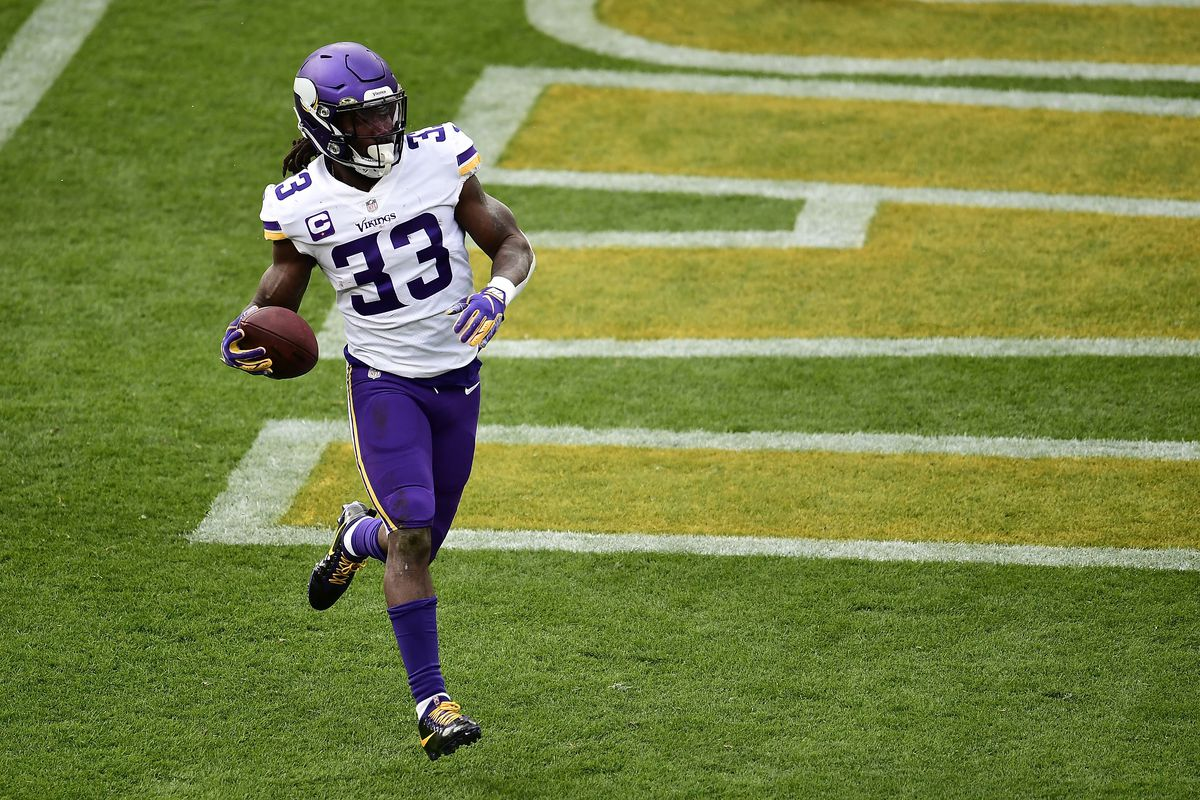 Dalvin Cook #33 of the Minnesota Vikings rushes for a touchdown during a game against the Green Bay Packers at Lambeau Field on November 01, 2020 in Green Bay, Wisconsin.