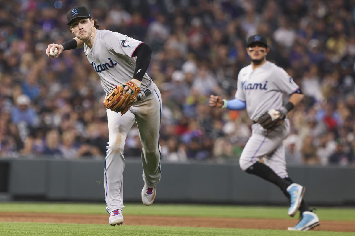 Miami Marlins third baseman Brian Anderson (15) throws tor retire Colorado Rockies shortstop Trevor Story (not pictured) in the sixth inning at Coors Field