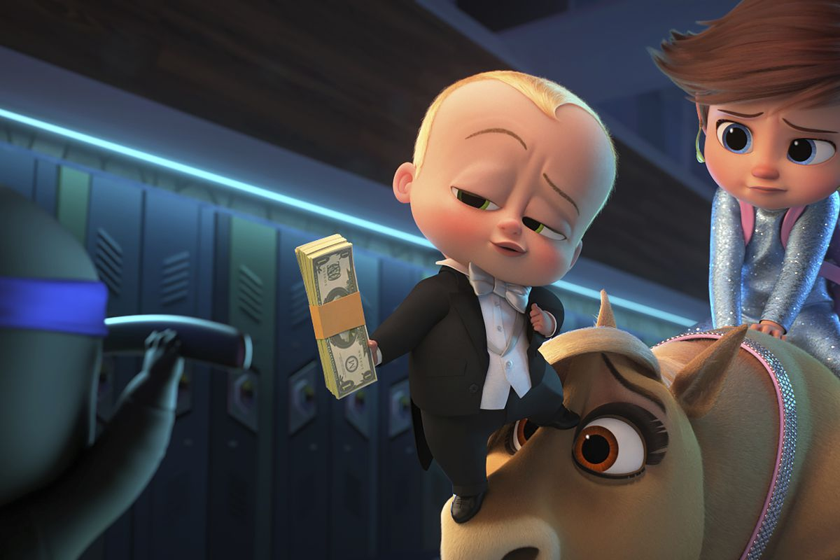 """This image released by DreamWorks Animation shows The Boss Baby/Ted Templeton, voiced by Alec Baldwin (center) and young Tim Templeton, voiced by James Marsden, in a scene from """"The Boss Baby: Family Business."""""""