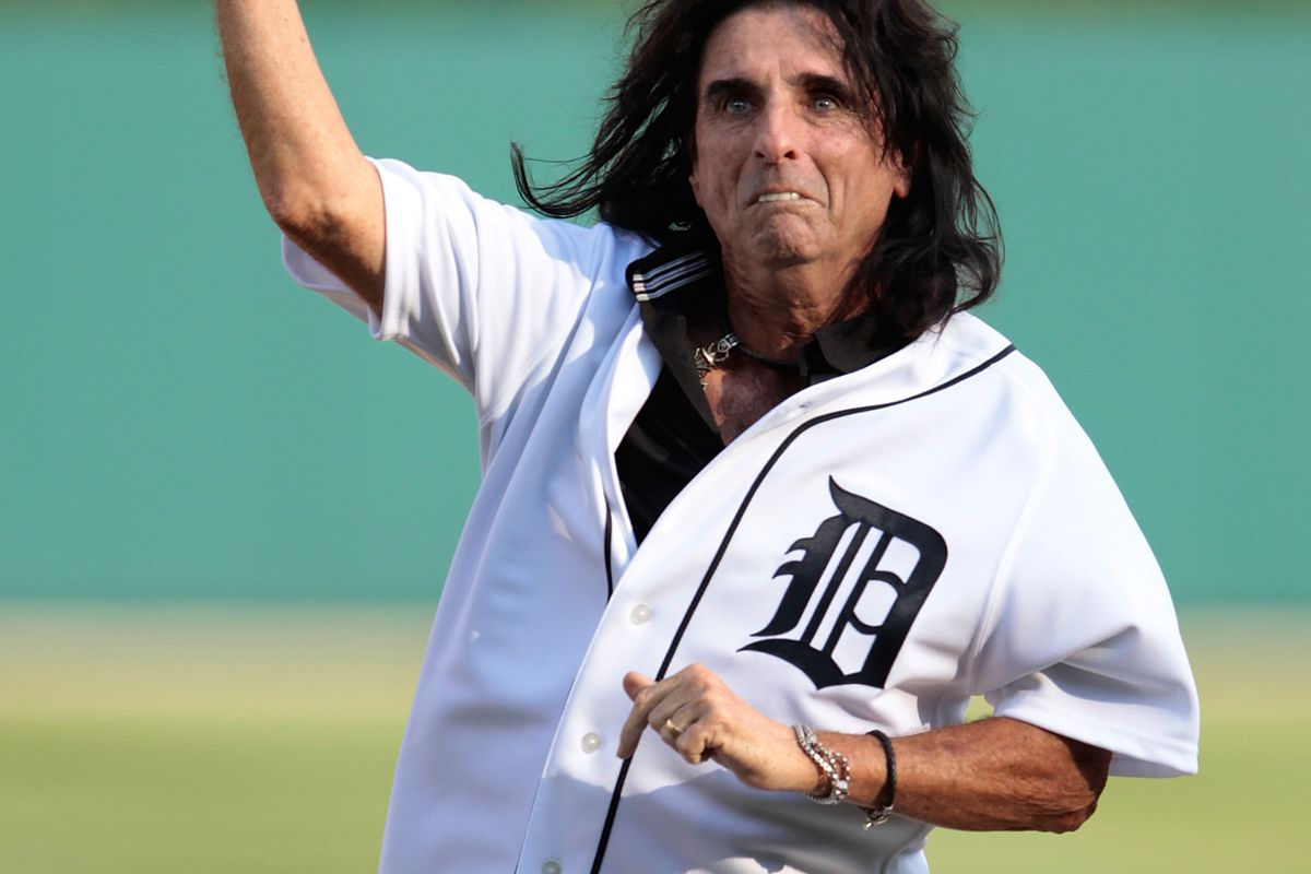 Alice Cooper throws out the first pitch prior to the start of the game between the Los Angeles Angels of Anaheim and the Detroit Tigers at Comerica Park on July 17, 2012 in Detroit, Michigan.