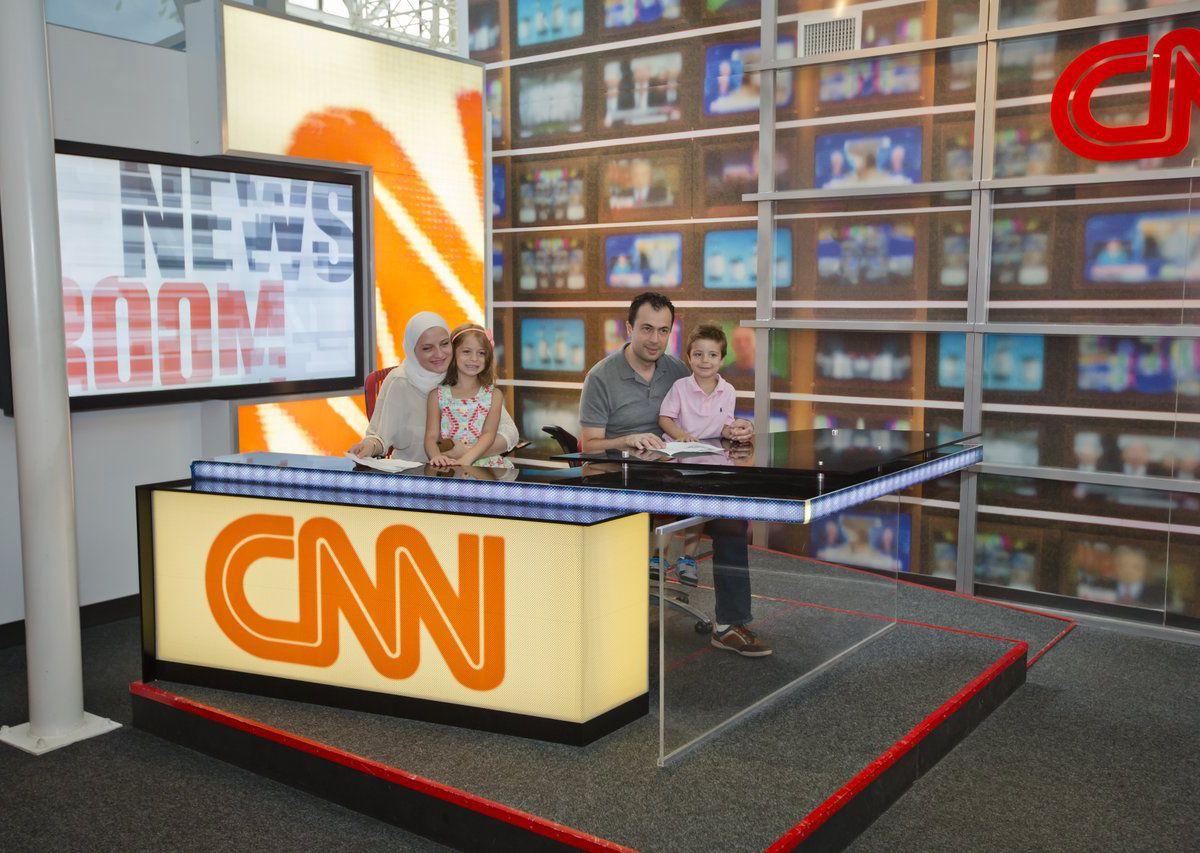 Family sitting at CNN desk.