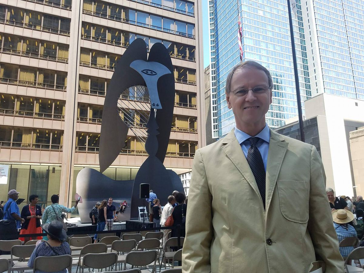 Mark Dykstra, 58, looked on at Tuesday's 50th anniversary ceremony half a century after he saw the original event unveiling the Picasso sculpture in the Daley Plaza. | Nader Issa/Sun-Times