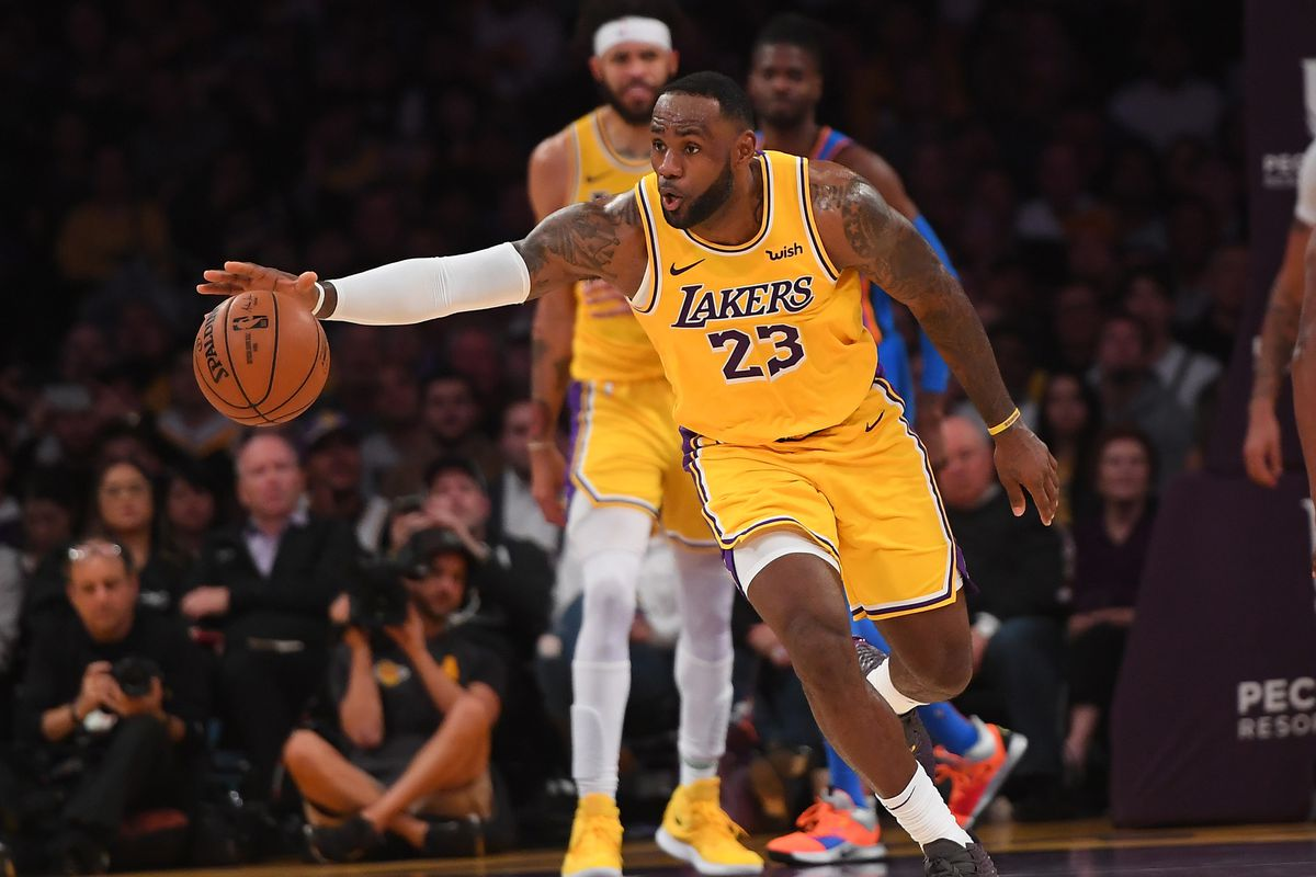 Los Angeles Lakers forward LeBron James reaches for a loose ball in the second half of the game against the Oklahoma City Thunder at Staples Center.