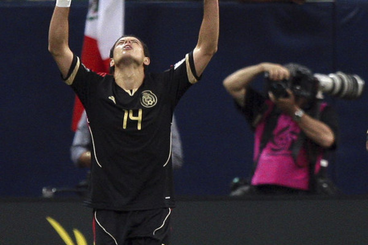 HOUSTON - JUNE 22:  Javier Hernandez #14 of Mexico celebrates his goal in the first overtime period against Honduras at Reliant Stadium on June 22, 2011 in Houston, Texas. Mexico won 2-0.  (Photo by Bob Levey/Getty Images)