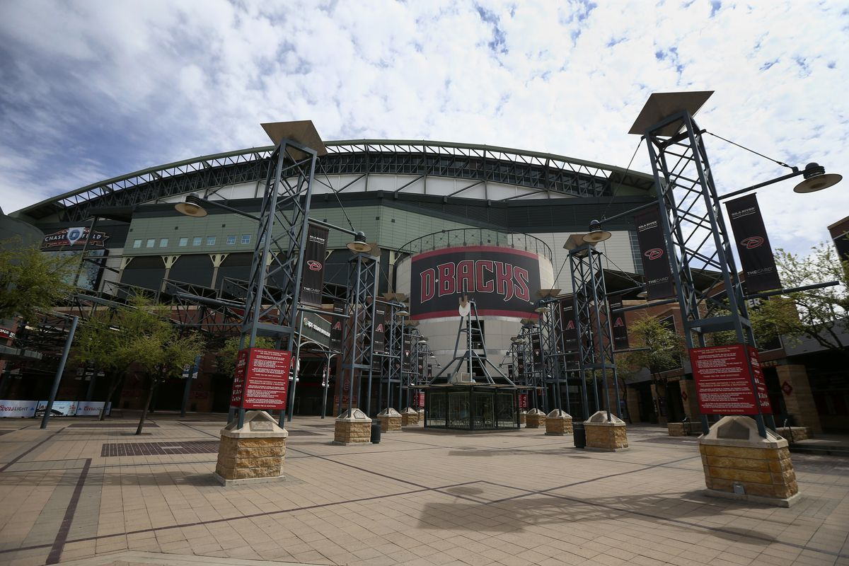 The main entrance in front of Chase Field is devoid of activity Thursday, March 26, 2020, in Phoenix.. The Arizona Diamondbacks would have hosted the Atlanta Braves in their season-opening baseball game Thursday, but the start of the MLB regular season is indefinitely on hold because of the coronavirus pandemic. (AP Photo/Ross D. Franklin)